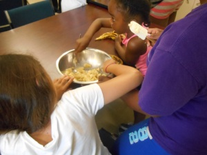 Our future bakers mashing bananas for their delicious banana muffins!