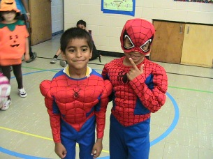 Campers wearing matching Spiderman costumes.