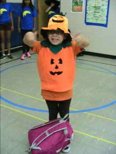Camper dressed as a pumpkin.