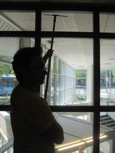 Miguel admiring the view while  he finishes up cleaning the windows.