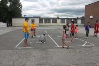 FOY Staff Karina and Jose playing 4 squares with the kids
