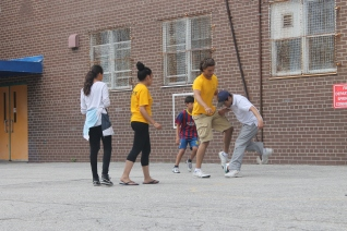 FOY Staff Jasmine and Evian playing soccer with the kids