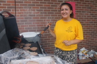 FOY Staff, Leanne cooking some burgers and hotdogs