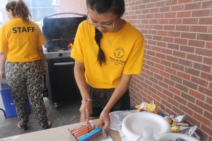 FOY Staff, Kim, helping cook