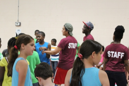The staff and campers preparing to begin an activity