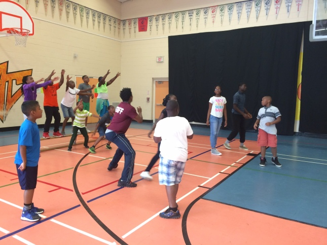 Staff and campers playing a game of dodgeball before lunchtime