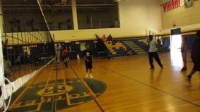 An intense game of volleyball going on