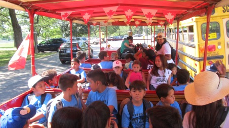 The campers ride on the train to tour High Park