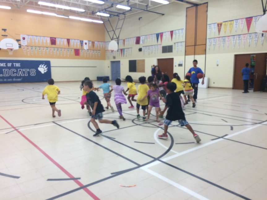 Campers playing a game of What Time is it Mr. Wolf in the gym