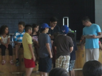Older campers get ready to tell jokes in the cafeteria