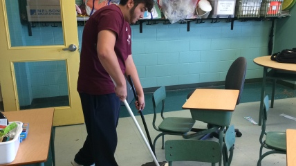 He also sweeps and mops the floors of the classroom