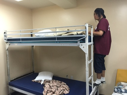 Natalie climbing to start making the upper bunk