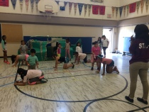 Tyra and campers rehearsing their performance.