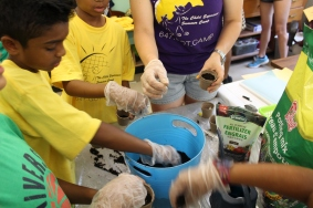 Campers learning how to plant!