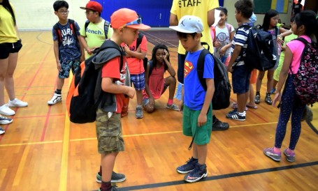 Two campers compare the day's outfits.