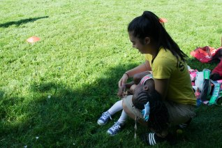 A camper takes a much needed break in the arms of a FOY staff.