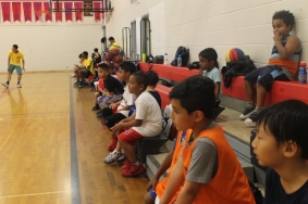 Campers cheering their buddies from the bleachers.