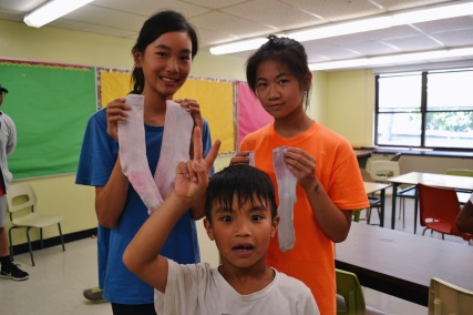 Campers showing off their tie-dyed socks.