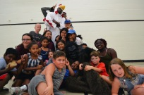 The campers having a fun time with the staff.