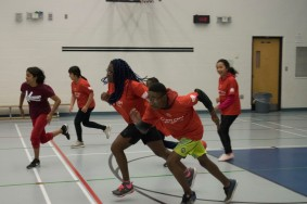 Campers running as fast as they can in a game of asteriod
