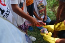Campers tie-dyeing their shirts outside.