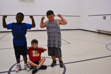 Campers flexing their muscles after a game of Doctor Dodgeball.