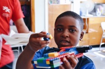Camper showing off his lego car.