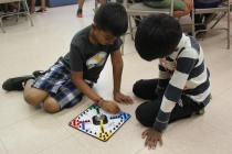 Campers playing board games during lunch break.