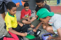 Campers looking and playing at their Pokemon cards