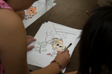 Camper colouring a picture of Nemo